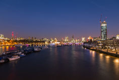 City of London Skyline. The City of London Skyline at Dusk showing boats, buildings and construction. There is copy space in the image Royalty Free Stock Photography