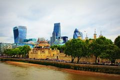 City of London skyline London Great Britain. The City of London and Tower of London seen from the Tower Bridge on the river Thames in London, United Kingdom.The stock photos