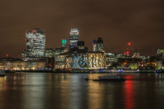 City of London skyline at night. City of London skyline and the river Thames at Stock Photo