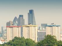City of London skyline over green trees.  Stock Photo