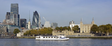 City of London skyline with river tour boat Royalty Free Stock Photo
