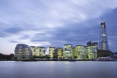 City of London Skyline At Sunset. New London City Hall at night , panoramic view from river Royalty Free Stock Photo