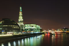 City of London: skyline of Thames bank at night. Night view on the The City of London business center on the Thames bank, taken from the Tower Bridge, London Royalty Free Stock Photography