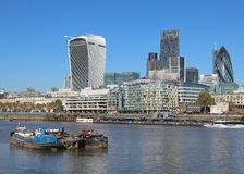 City of London skyline and the Thames. City of London skyline, including iconic buildings such as the Gherkin (30 St. Mary Axe), 20 Fenchurch Street (the walkie Royalty Free Stock Photos