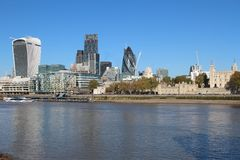 City of London skyline and the Thames. City of London skyline, including iconic buildings such as the Gherkin (30 St. Mary Axe), 20 Fenchurch Street ('the walkie Royalty Free Stock Image