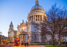 City of London. St. Paul cathedral and red British busses in dusk. Stock Images