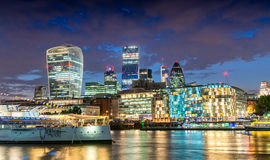 City of London. Stunning skyline at dusk with Thames river refle Stock Photo