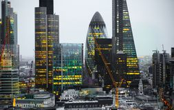City of London at sunset. Famous skyscrapers City of London business and banking aria view at dusk. London, UK. London, UK - December 19, 2015: City of London at stock photos