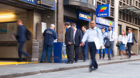 City of London, tube commuters walking in front of London's tube station. Business people blur. LONDON, UK - APRIL15, 2015: City of London, tube commuters Royalty Free Stock Image
