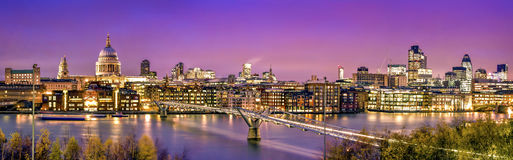City of London at twilight. Panoramic picture of St. Paul's Cathedral, Millennium Bridge and  the Financial District at twilight Stock Photography