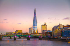 City of London at twilight, Shard, view from the river Thames. LONDON, UK - SEPTEMBER 10, 2015: City of London, Shard, view from the river Thames at twilight stock photo