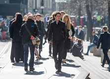 City of London, Walking business people on the street. UK. London, UK - March 15, 2017: Lots of walking business people in the City of London. Modern busy Royalty Free Stock Photos
