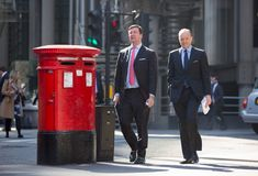 City of London, walking business people on the street. UK Royalty Free Stock Photography