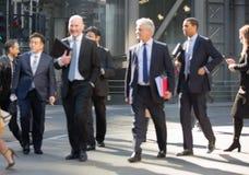 City of London,  walking businessmen  on the street. UK Stock Images