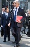 City of London,  walking businessmen  on the street. UK Stock Image