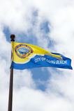 City of Long Beach flag. In a cloudy day. the flag is yellow and blue Stock Photography