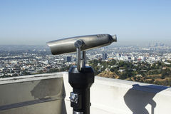 The city of Los Angeles serves as a backdrop to this coin operat. The city of Los Angeles serves as a beautiful backdrop for coin opereated observation telescope Royalty Free Stock Photos