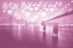 City of love. With shiny hearts floating above Stock Photos