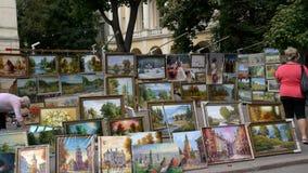 The city Lviv in Ukraine. LVIV, UKRAINE - AUGUST 25: Art market and street painting artist on August 25, 2011 in Lviv, Ukraine Royalty Free Stock Photo