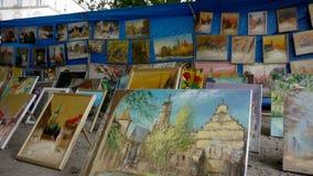 The city Lviv in Ukraine. LVIV, UKRAINE - AUGUST 25: Art market and street painting artist on August 25, 2011 in Lviv, Ukraine Stock Photography