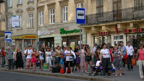 The city Lviv in Ukraine. LVIV, UKRAINE - AUGUST 25: Many people waiting for a bus in a bus stop on August 25, 2011 in Lviv, Ukraine Stock Photos