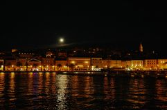 City Mali Losinj seen from the sea in night mode. With reflection of the city on the sea Royalty Free Stock Image
