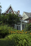 City Mansion Lawn Garden. A city of Buffalo home that is know for its garden lawn combo and has been in many garden walks stock photos