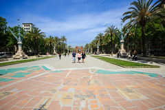City map on a ground in the alley near Triumphal arch. Barcelona, Spain - May 27, 2016: many tourists near the Arc de Triomphe in sunny summer day, city map on Royalty Free Stock Image