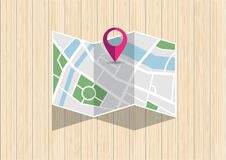 City map with mark pin folding on wooden desk. Top view of GPS city map with mark pin folding on wooden desk. City map search place for direction. Vector