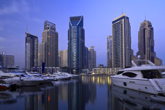 City marina. Speedboats moored in a marina with waterfront skyscrapers behind Royalty Free Stock Photo