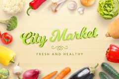 City market fresh and healthy text on kitchen wooden table surrounded with fresh vegetables Stock Image