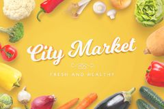 City Market grocery store text surrounded with organic fresh vegetables on yellow table Royalty Free Stock Photography