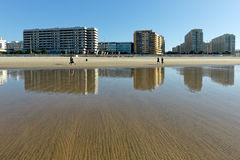 City of Matosinhos reflected on the wet sand Royalty Free Stock Photography