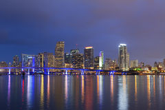 City of Miami. Image of Miami skyline and reflection of the city lights during twilight blue hour royalty free stock image