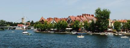 Mikolajki embarkment over Sniardwy lake. City of Mikolajki in Masuria region in Poland Royalty Free Stock Image