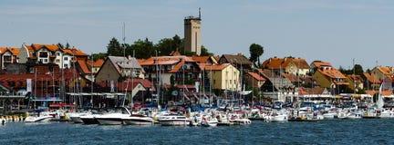 City of Mikolajki in Masuria. View on Mikolajki embarkment with marina Royalty Free Stock Photo