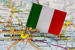 City of milan with Italian flag. An old roadmap of the city of Milan (Milano). In the center plugged with the Italian flag. Focus is where the flag enters the stock photos