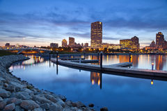 City of Milwaukee skyline. Image of Milwaukee skyline at twilight with city reflection in lake Michigan and harbor pier Royalty Free Stock Images