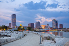 City of Milwaukee skyline. Image of Milwaukee skyline at twilight with city reflection in lake Michigan and harbor pier Stock Images