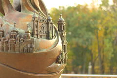A city in miniature on a bronze ball Stock Photos