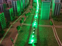 A city in miniature. Roads, buildings, green lights, and trees in a miniature model city Stock Images