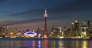 City Modern Skyline Colorful Toronto Lake Reflections Timelapse. Views of the Toronto city skyline architecture from the Toronto Islands. Colorful city lights stock footage