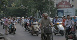 The city of motorbikes. Hanoi, Vietnam. HANOI, VIETNAM - OCTOBER 27, 2015: Stream of numerous motorbikes and few cars on busy highway. Domination of motorcycling stock video footage