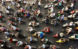 City of motorcycle transport. HO CHI MINH CITY, VIET NAM- MAR 27: Dense, crowed  scene of city traffic  in rush hour, crowd of people wear helmet, transport by Stock Photos