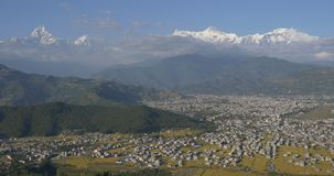 City in mountain valley stock footage