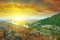 City in a mountain valley. And sunrise Stock Images