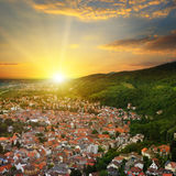 City in a mountain valley and the sunrise view from above Royalty Free Stock Photos