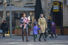 The city in movе, passersby on street Stock Photos