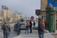 The city in movе, passersby on street waiting Royalty Free Stock Image