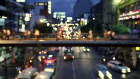 City on the Move. A time lapse film of a crowd and a lively street in Bangkok